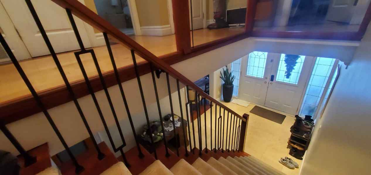 Iron spindle and glass handrail