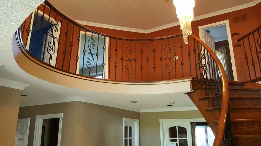 curve hallway and staircase iron balusters oakville
