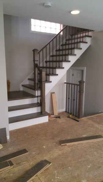 brown  staircase oak with iron balusters oakville