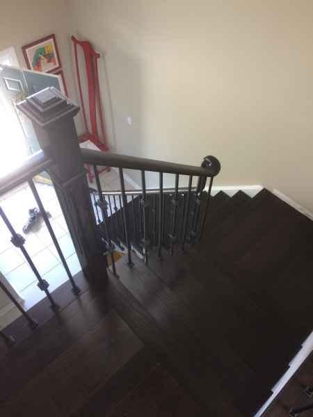 dark staircase box newel iron balusters