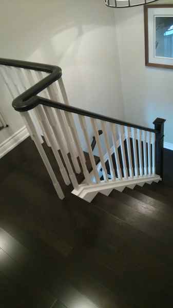 Dark staircase white chamfered wood balusters