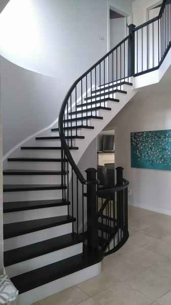 dark curve staircase with plain iron balusters