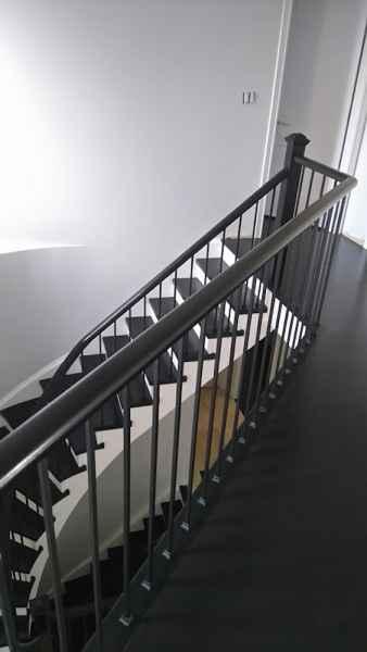 Dark staircase plain iron balusters
