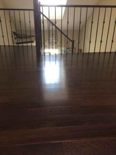 upper hallway hardwood floor iron balusters