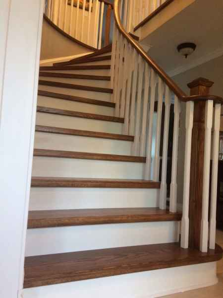 gunstock hardwood stairs with white chamfered balusters